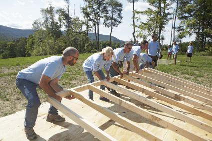 Construction volunteers building a house