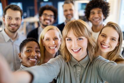 Smiling workers take selfie