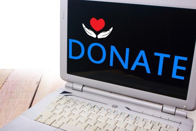 Laptop with the word donate on the screen