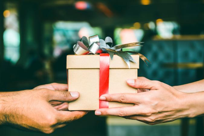Two hands holding a present