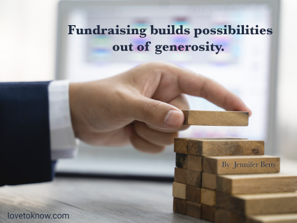 Hand arranging wood block stacking as step stair and fundraising quote