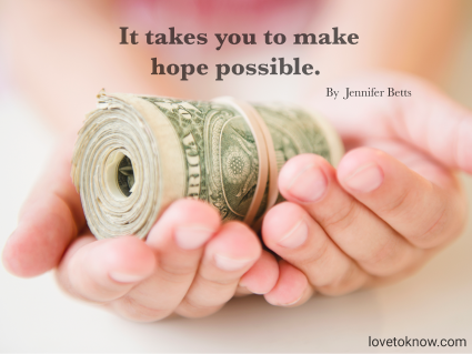 Girl's hands holding money roll and fundraising quote