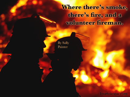 Silhouette of firefighters against fire and volunteer quote