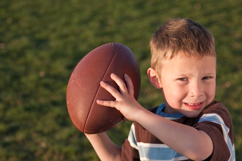 https://cf.ltkcdn.net/cheerleading/images/slide/51591-849x565-little-boy-football.jpg