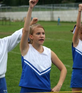 Girl cheering at a game