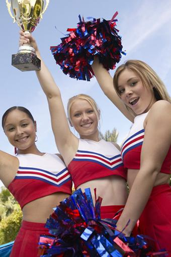 Cheerleaders with trophy