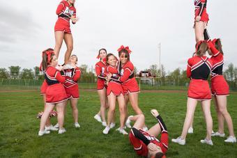 Fallen cheerleader during routine