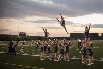 Cheerleading team cheering and jumping