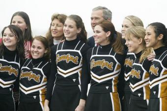 George W. Bush with cheerleaders