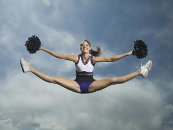 Cheerleader jumping in air