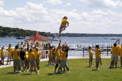 cheerleaders practicing a stunt