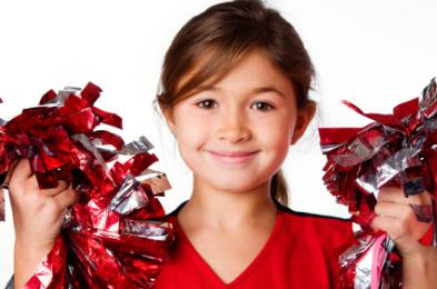 Young cheerleader wearing red