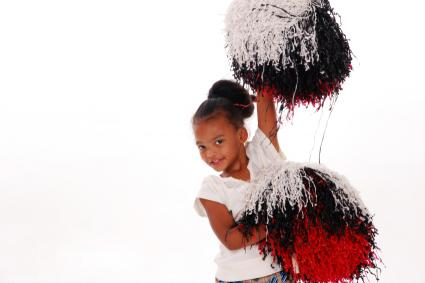 young-cheerleader-with-poms.jpg