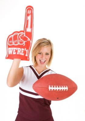 Cheerleader with a number one foamie