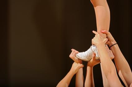 Cheerleaders performing stunt