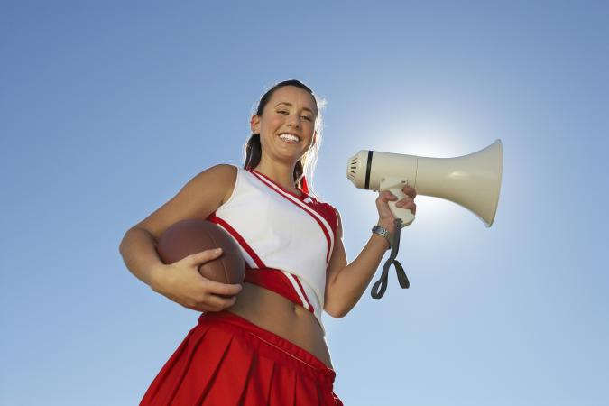 Cheerleader using a megaphone