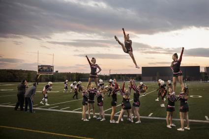 Cheerleading team cheering and jumping