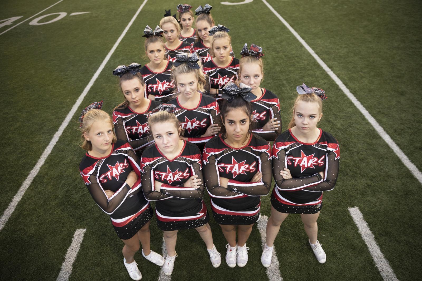 High school cheerleading team on football field