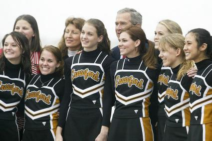 George W. Bush with cheerleaders