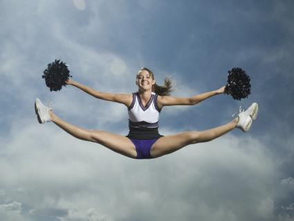 Cheerleader jumping in air