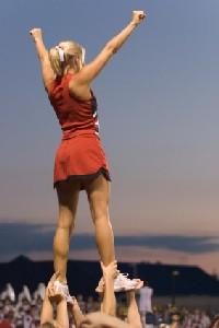 cheerleader performing a stunt