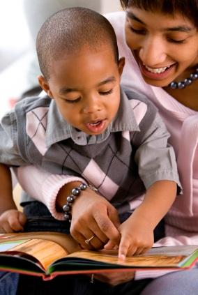 boy reading with mother