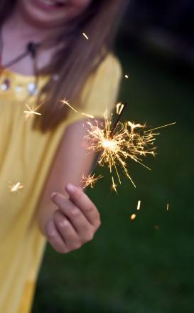 Child holding a sparkler