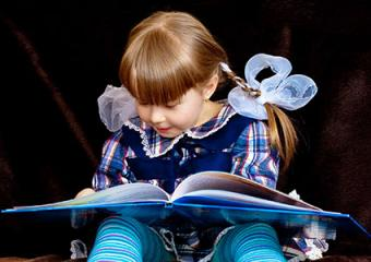 Child reading fairy tale