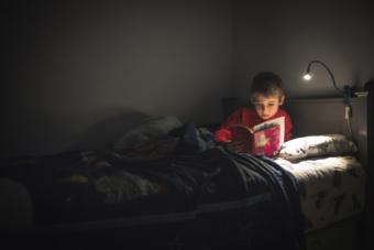Boy reading in bed