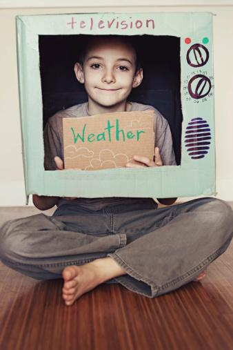 Young Boy Playing Pretend TV