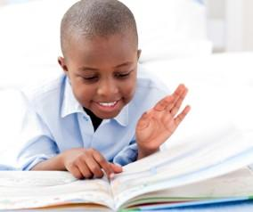 African-American boy reading a book