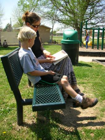 A boy reading with an adult
