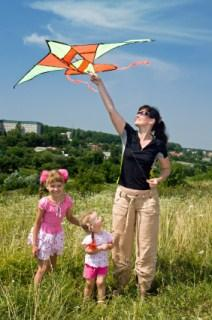 mom with girls and kite