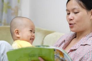 woman reading to baby