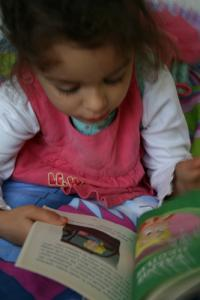 Girl reading a picture book.