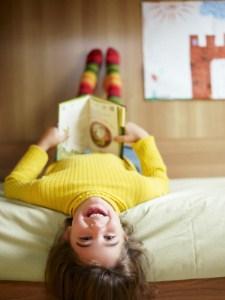 girl reading upside down