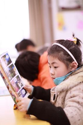 Girl reading Manga book