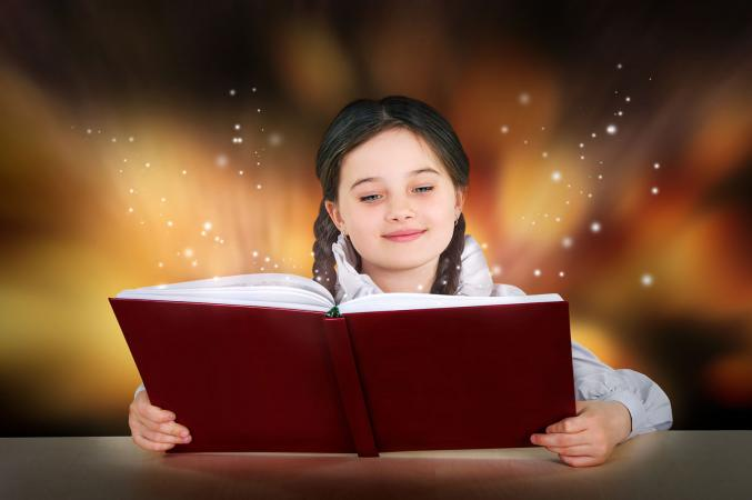 Girl reading a magical story book