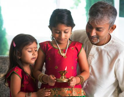 Indian family in traditional sari celebrate diwali