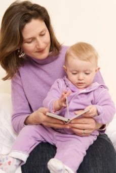 baby and mother reading