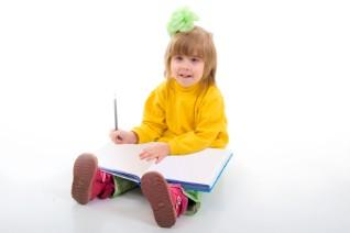 girl writing in large book