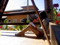 A girl reading outside.