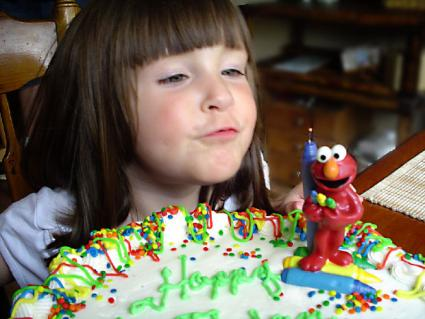 A child with a birthday cake.