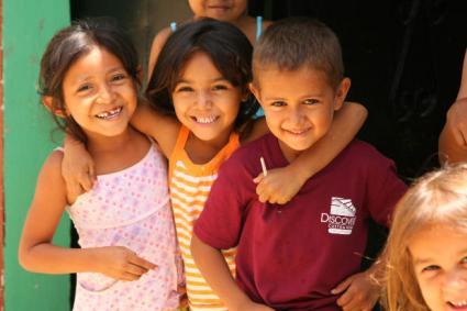 Three smiling kids.