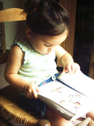 A small girl reading.