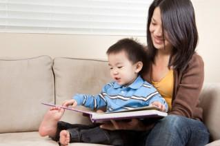 son and mother read together