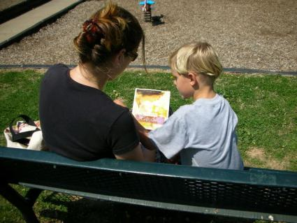 Boy and mom reading together.
