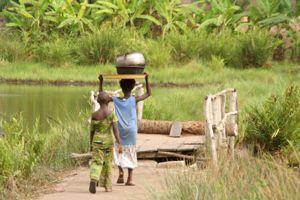 two African children on bridge