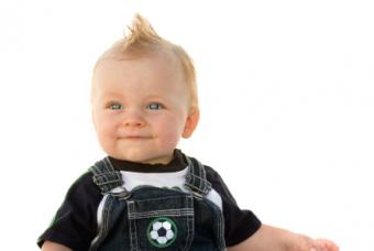 cute baby boy in overalls