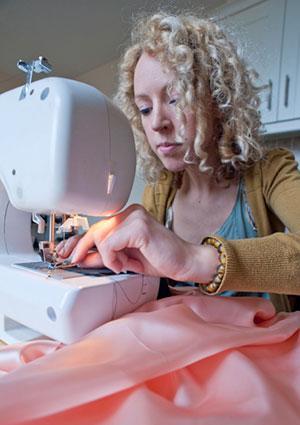 Mom sewing pagaent dress